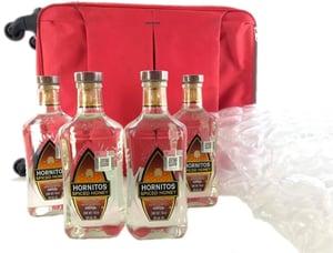 Cuantas botellas de alcohol permitidas llevar en el avión